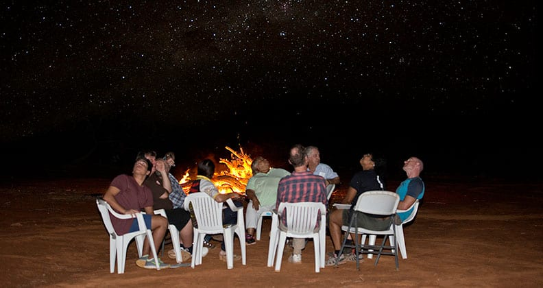 The group sits beneath the stars at the remote Murchison Radio-astronomy Observatory