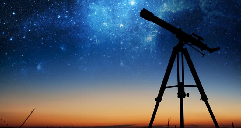 A telescope in front of the night sky
