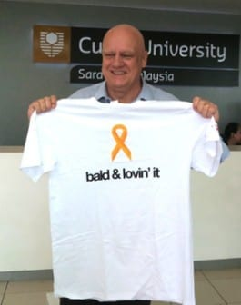 Professor Mienczakowski proudly showing off his shaven head and Go Bald T-shirt.