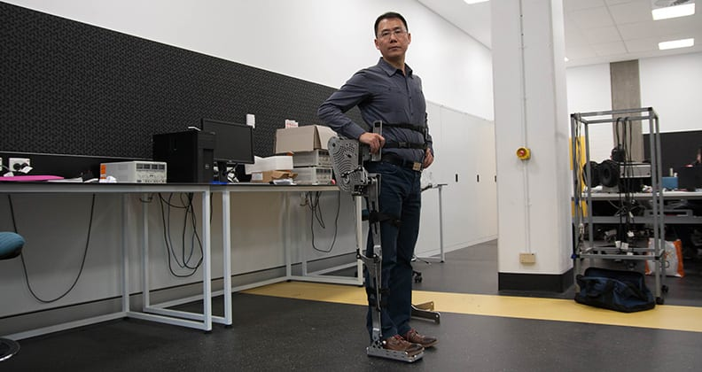 Dr Lei Cui wearing his leg exoskeleton.