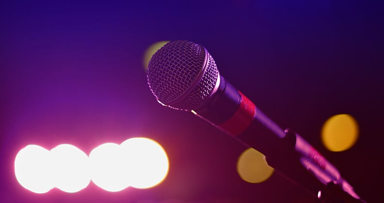 Close up of microphone against a lit background