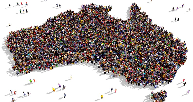 Large diverse group of people seen from above gathered together in the shape of Australia.