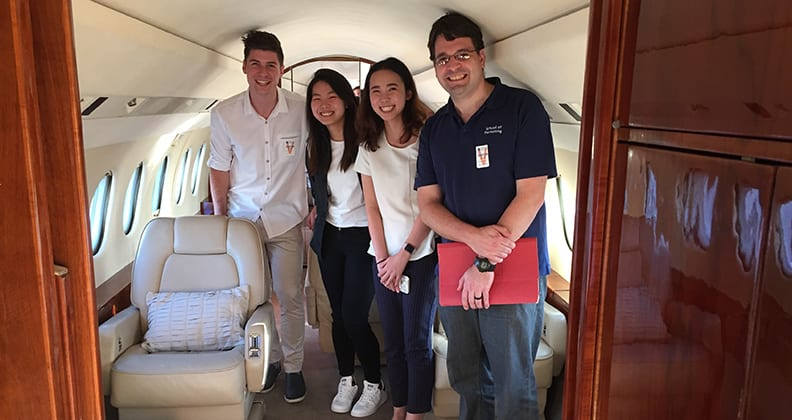 Four Curtin marketing students inside a private aircraft.