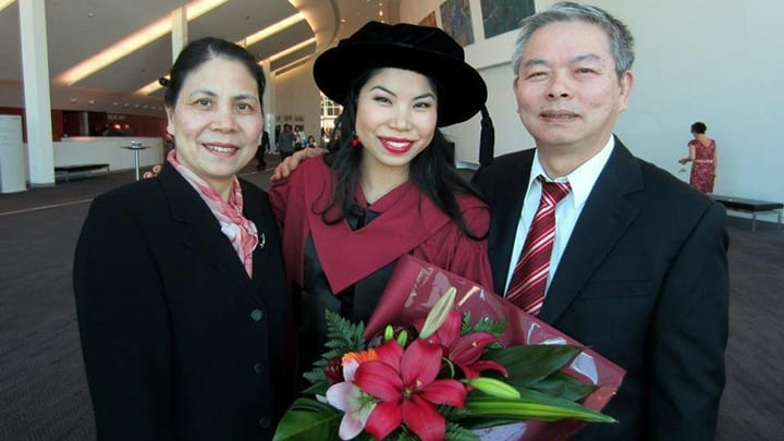 Dr Lam at her PhD graduation with her parents.