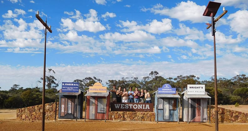 Medicine students from Curtin and Notre Dame in front of the Westonia welcome sign.
