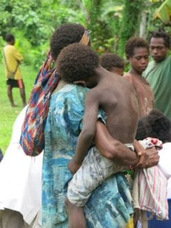Child being carried in PNG.