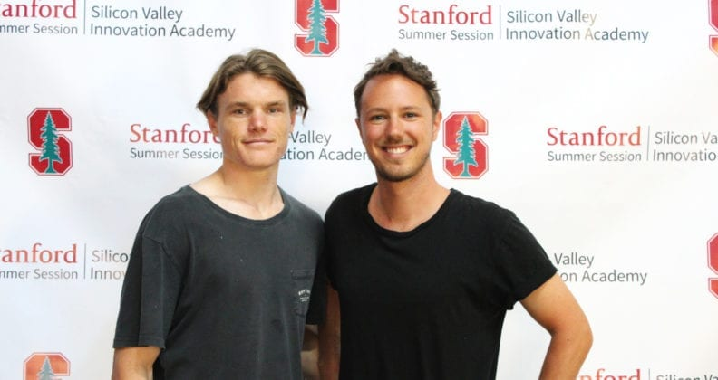 Willem Poot and Zac Farrow stand against a Stanford University backdrop.