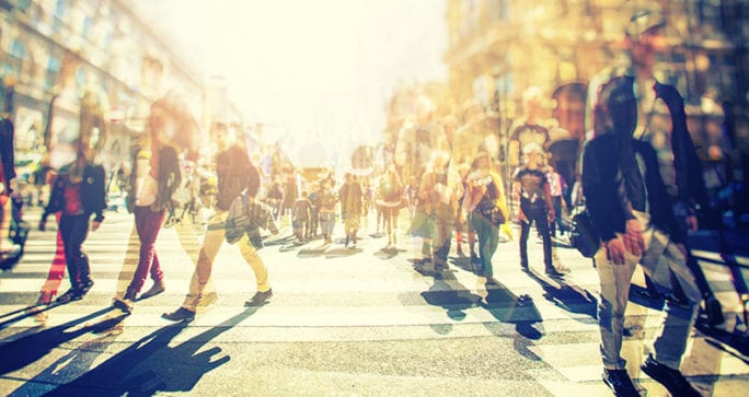 A group of people walking down a crowded street