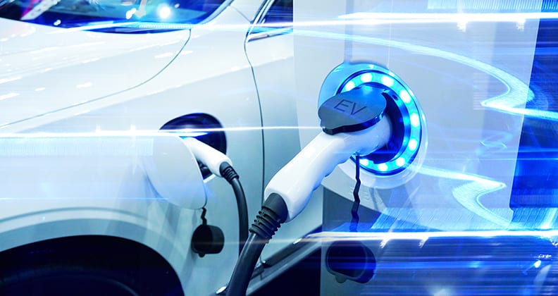 Power supply connect to electric vehicle for charge to the battery. Charging technology industry transport which are the futuristic of the Automobile. EV fuel Plug in hybrid car