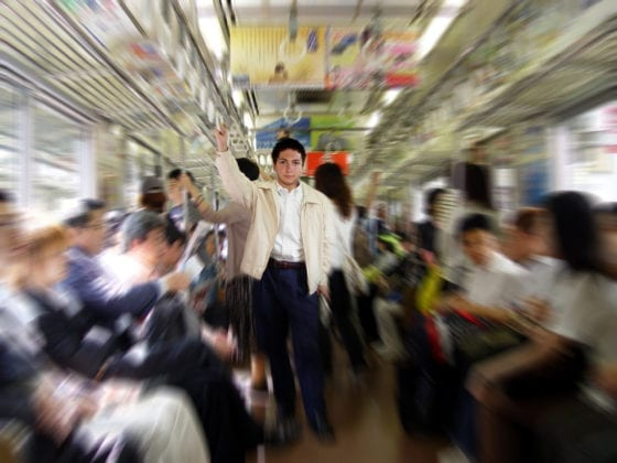 Man standing on crowded train