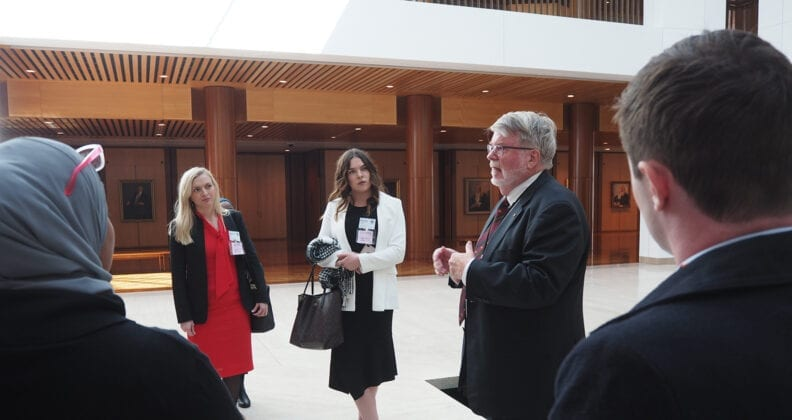 Rachael Ryan and Niamh Wilkins with former Speaker of the House of Representatives Harry Jenkins AO at Parliament House.